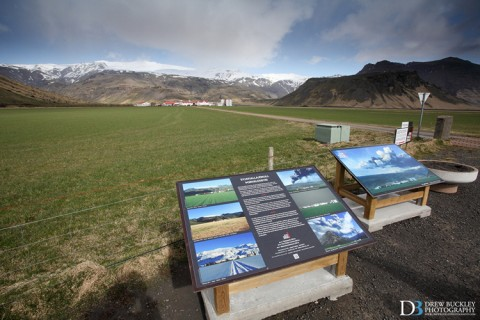 Information boards displaying images of the eruption above this farm