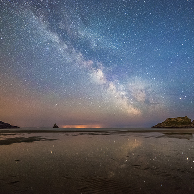 Milky Way streak across the sky at Broad Haven beach in south Pembrokeshire, Wales