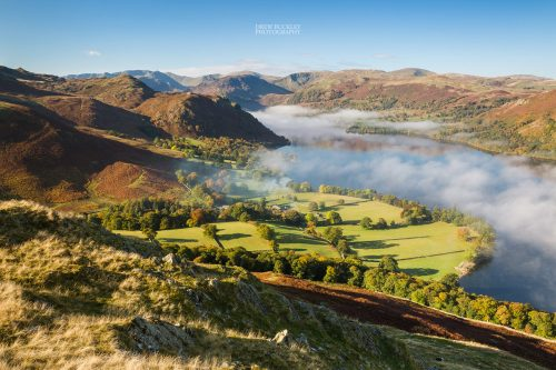 Autumnal misty dawn looking across Ullswater in the Lake District, England